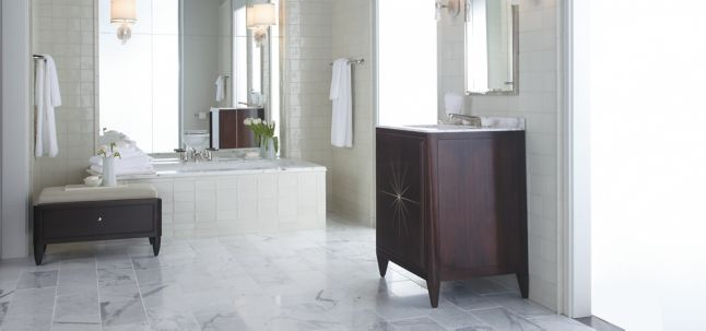 "16"" x 16"" field in honed finish and Barbara Barry Starburst Celedon Gloss field with KALLISTA Barbara Barry Counterpoint 30"" vanity, deck-mount bath set with lever handles, 24"" towel bar, rock crystal wall sconce, widespread basin set with marble knob handles, mirrored medicine cabinet, and Barbara Barry Original 5' bath with drop-in"