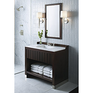 Shown is the Original For Him Dressing Table in Java with White Carrara Mable Top, Undercounter Basin in Stucco White, Tuxedo Showerhead and Trim and Basin Faucet For Him in Brushed Nickel