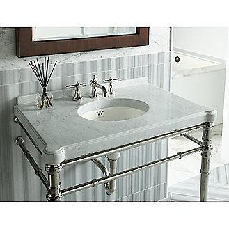 Shown is the Inigo Console Table in White Carrara, Michael S Smith Undercounter Basin in Stucco White, Inigo Basin Set in Nickel Silver