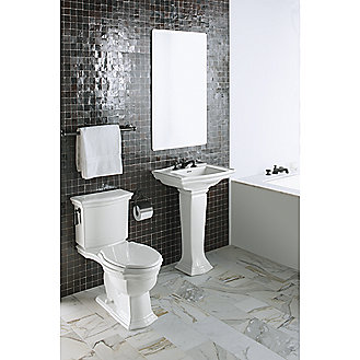 Shown is the Hampstead 2-Piece Toilet in Stucco White, Elongated Colored Wood Toilet Seat in Stucco White with Chrome Trim, and Chrome Trip Lever