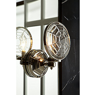 Shown is the For Town Sconce in Nickel Silver and features the Baccarat Crystal Lens in Crystal Clear