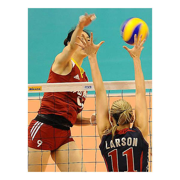 Jordan Larson putting up block against China