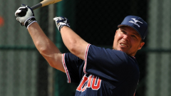 Chipper Jones watches his home run go over the fence