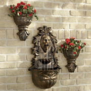 antiqued lion s head wall fountain with planters
