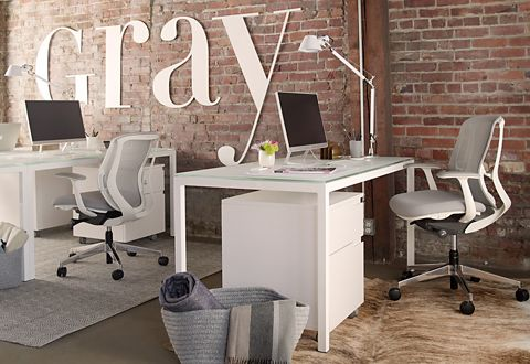 Modern white Pratt desks with white Milo rolling under-desk file cabinets keep the office light and bright.