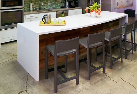 The office break room furniture includes a full kitchen with durable Room & Board modern gray counter stools.