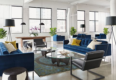 This inviting lobby has comfortable seating to accommodate clients and guests. Blue velvet Sabine sofas and chairs and black leather Lira chairs provide ample seating. Two Fuller cocktail tables balance the space.