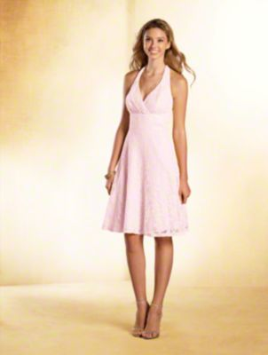 A short princess bridesmaid dress with halter neckline, natural waist with cummerbund, and A-line skirt with pockets.