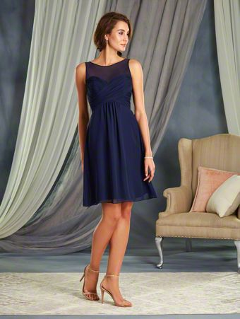 A Cocktail Length, A-Line Style, Short Bridesmaid Dress With An Empire Waist And A Tie-Back Illusion Yoke Neckline.
