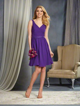 A Cocktail Length, A-Line Style, Short Bridesmaid Dress With A V-Shaped Neckline And Satin Waistband Accent At The Natural Waistline.