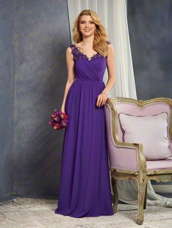 A Full Length, A-Line Style, Long Bridesmaid Dress With Illusion Straps Decorated In Lace Medallions.