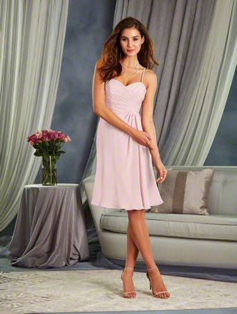 A Cocktail Length, A-Line Style, Short Bridesmaid Dress With An Asymmetric Empire Waist And Spaghetti Straps.