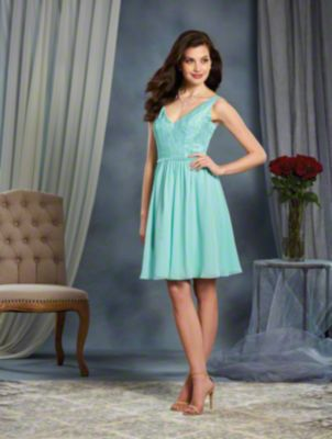 A Cocktail Length, Bridesmaid Dress With A Natural Waist, Lace Underlays And A V-Neckline.