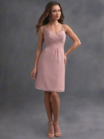 A romantic short bridesmaid dress with illusion straps, sweetheart neckline, draped bodice, and shirred skirt.