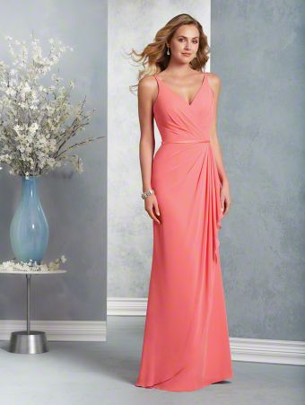 A long modern bridesmaid gown with a V-shaped neckline, spaghetti straps, banded natural waist, and a draped, fluted skirt.