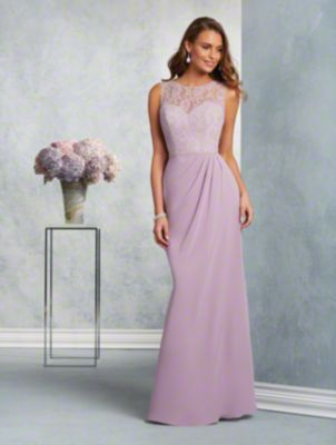 A long, romantic bridesmaid gown with sweetheart neckline, sheer, sleeveless lace yoke, and fluted skirt.