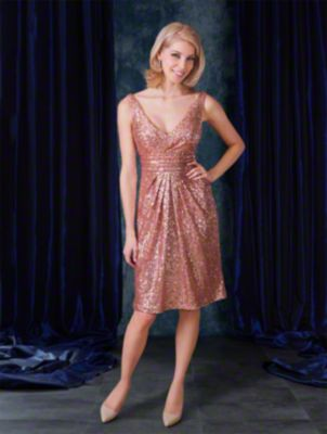 A cocktail length sequined sexy bridesmaid dress with draped v-neckline, shoulder straps, cummerbund, and pleated skirt.