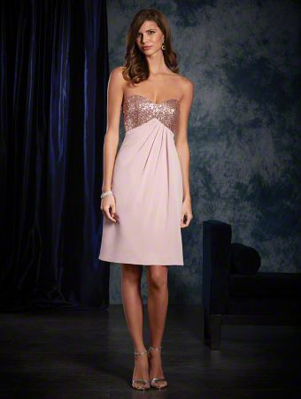 A sexy short bridesmaid dress with a strapless, sweetheart neckline, empire waist, and draped cocktail skirt.