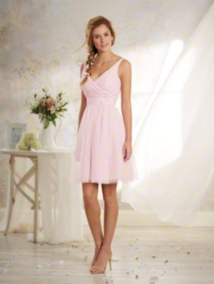 A Vintage Style, Short Bridesmaid Dress With A V-Neckline And Natural Waist With Embroidered Lace Detail.
