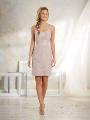 A Vintage Style, Short Bridesmaid Dress With Sheer Shoulder Straps And Natural Waist With Embroidered Lace Detail.