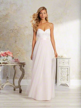 A boho chic, long bridesmaid dress with strapless, sweetheart neckline, natural waist, and floor length skirt.