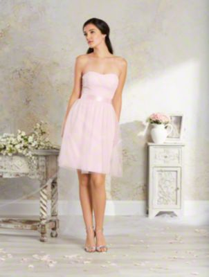 A short, shabby chic bridesmaid dress with strapless, dipped neckline, asymmetrically draped bodice, and cocktail skirt.