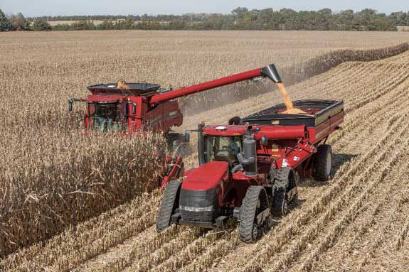 This is a photo of a combine harvesting corn.