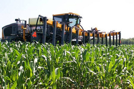 High-clearance applicator with a crop sensor directing in-season N application.