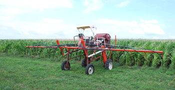 A high-clearance sprayer modified to seed cover crops into standing corn.