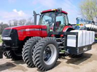 Case IH tractor equipped with tanks for liquid starter application at planting.