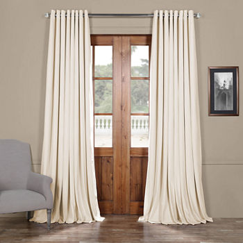 Exclusive Fabrics Furnishing Signature Extra Wide Grommet Top Blackout Velvet Curtain Panel