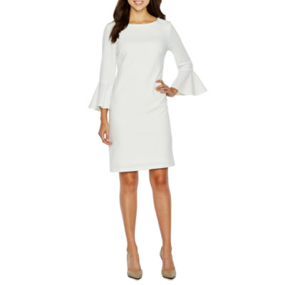 White peplum dress in chinet advertisement