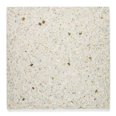 """12"""" x 12"""" field in crème with light aggregate and brass"""