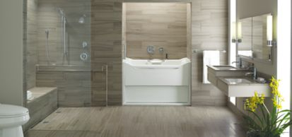 """8"""" x 16"""" field in honed finish and KOHLER bottle trap with contemporary round, 7-1/2"""" showerarm and flange, 30"""" shower slidebar, Purist 24"""" towel bar, single-function showerhead with Katalyst function, slidebar trim kit, wall supply elbow, single-control lavatory faucet with straight lever handle, Rite-Temp pressure-balancing valve faucet trim with lever handle, deck-mount handshower holder with hose, stacked valve trim with lever handle, two-way transfer valve trim with lever handle, 12"""" grab bar, single wall sconce, MasterShower 72"""" metal shower hose, Belay 54"""" aluminum hand rail, Clearflo shower drain tile-in, slotted overflow bath drain, Shift multifunction handshower with black handle, Flipside 01 handshower with traditional design and Flipstream technology, Ladena lavatory undermount, Elevance 5' bubble massage bath with rising wall, right-hand drain, and grab bar, San Raphael one-piece toilet with comfort height, elongated Power Life, integrated C3-200 bidet seat, and ROBERN Uplift 30"""" x 27"""" mirrored cabinet (photographer: Mike Huibregtse)"""