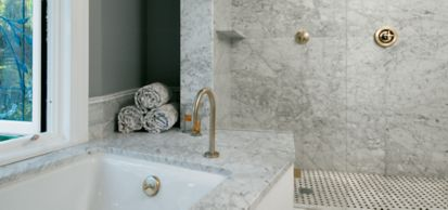custom size marble field and wicker marble mosaic with nero marquina marble in honed finish and carrara marble tub deck
