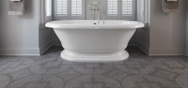 "12-1/8"" x 12-1/8"" barcelona field in grey with white and light grey marble with KALLISTA Town Bath Set in nickel silver with handshower, cross handles, bath set floor risers, and floor riser attachment (photographer: Rich Maciejewski, designer: Phoebe Howard, shown in: Southern Living)"