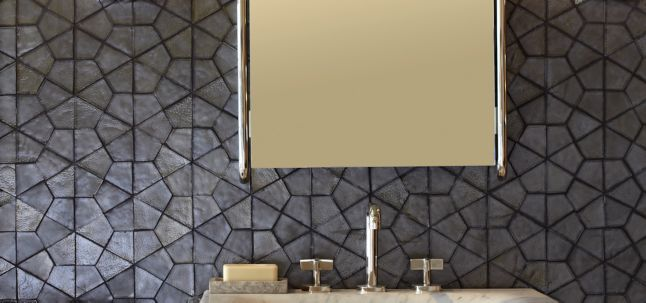 segmented hex mosaic in shadow irid with KALLISTA One mirror, wall sconce, console top, and console legs (photographer: Phillip Ennis, stylist: Jason Trotter)