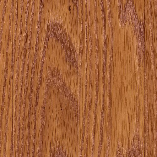 Mohawk Industries Vaudeville Cinnamon Oak Plank Laminate Grass