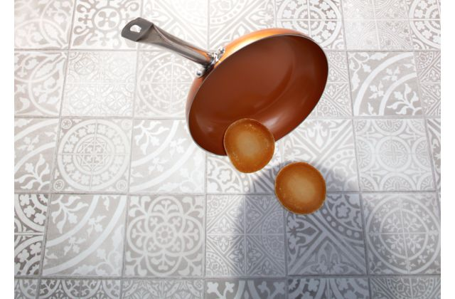 Cooking Pan and Pancakes Falling on Rigid Vinyl Flooring Tiles