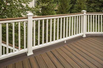 Transcend beveled deck rail in Tree House brown with black aluminum balusters