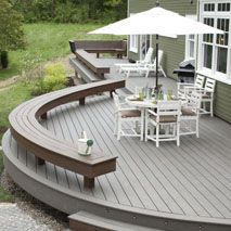 blog cabin deck design featuring trex transcend with furniture and umbrella
