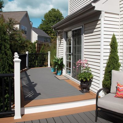 Trex Enhance composite decking in Clam Shell grey and Beach Dune brown