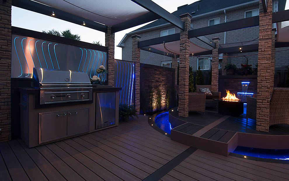 Custom round deck over water with outdoor kitchen and firepit