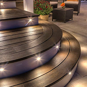 Illuminate your deck with discreet outdoor lighting from Trex. View this and more deck design pictures at our lighting inspiration gallery.