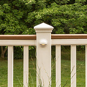 Traditional deck railing from Trex makes an elegant statement against this backdrop of trees.