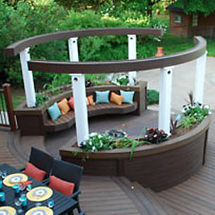 Trex Transcend decking in Spiced Rum is dressed with colorful pillows and plantings in this deck design by Paul LaFrance