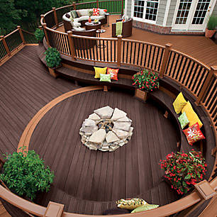 Experience enduring beauty with the graceful curves of this multi-level Trex deck.