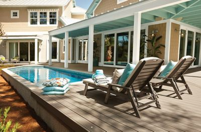 Trex Transcend decking in Gravel Path grey and Trex Outdoor patio Furniture frame on a pool deck as shown in the 2013 HGTV Smart Home