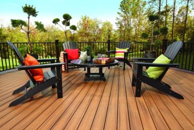 Trex Transcend decking, Reveal aluminum railing and Trex Outdoor patio Furniture create a sophisticated yet relaxed environment