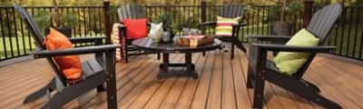 Trex Transcend decking, Trex Signature® aluminum railing and Trex Outdoor patio Furniture create a sophisticated yet relaxed environment